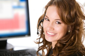 Smiling brunette by computer